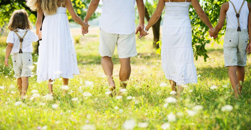A family holding hands outdoors