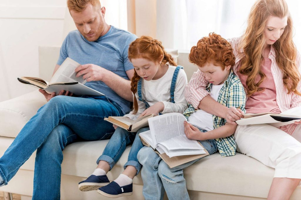 A family sat together reading